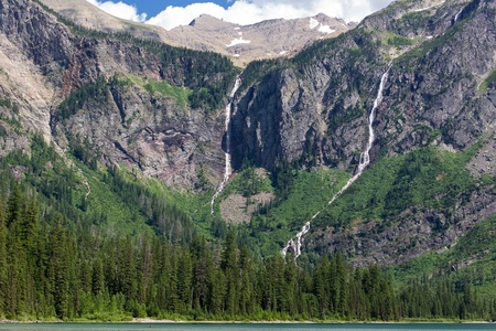 Waterfalls stream from the Sperry Glacier and Bearhat Mountain into Avalanche Lake in Glacier National Park, Montana