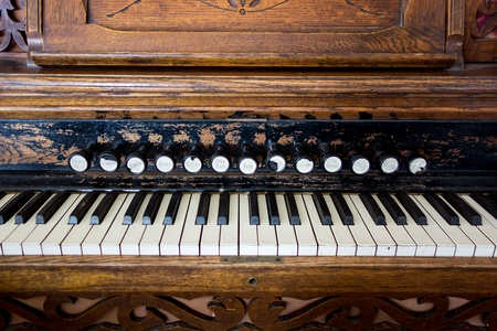 An antique pump organ in a pioneer church sits as a reminder of days prior to electricity and automation  Stock Photo