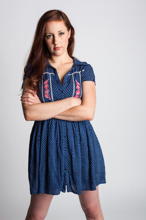 Serious Woman in Calico Dress