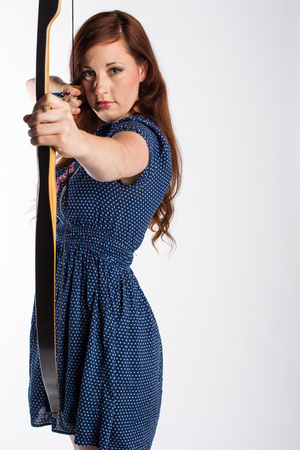 Female Archer With Bow Drawn Stock Photo