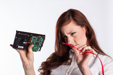 Woman Examines Hard Drive Connector Stock Photo