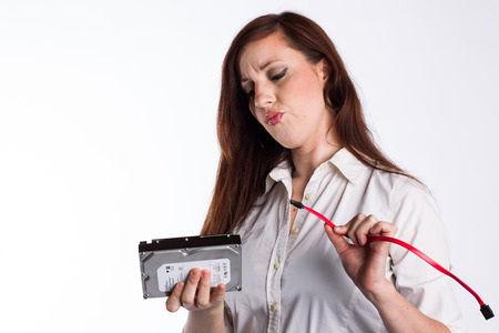 Confused Woman Attempts to Install Hard Drive