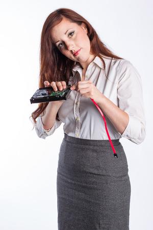 Woman Technician Installs Hard Drive