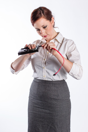 Woman Connects Hard Drive Cable Stock Photo