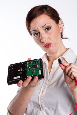 Confused Woman with Hard Drive Stock Photo