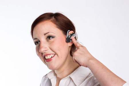 earpiece: Smiling Woman With Bluetooth Earpiece