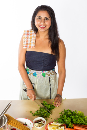 Smiling Indian Chef Cuts Herbs