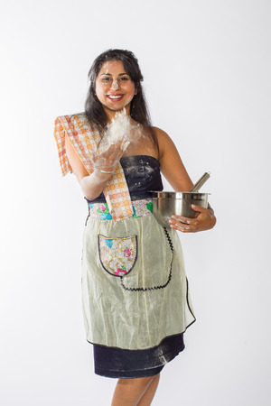 Indian Woman Tosses Flour Stock Photo