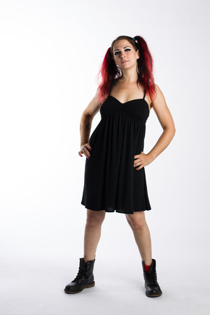 Serious Punk Girl in Combat Boots and Black Dress