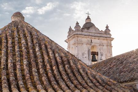Tile roofs and bell tower on the Church of Saint Matthew  Iglesia de San Mateo  in Tarifa, Spain  Stock Photo