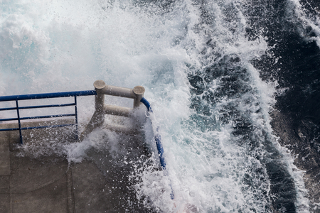 Water sprays and laps over the side of the jet ferry crossing between Tarifa, Spain and Tangier, Morocco