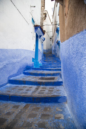 One of the hundreds of sets of stairs in the blue-painted mountain village of Chefchaouen, Morocco  Stock fotó