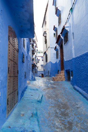 A rain soaked street in the blue-painted mountain village of Chefchaouen, Morocco  Stock fotó