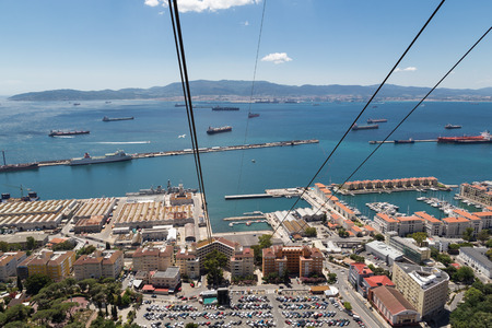 ascends: A view to Spain over the main port on Gibraltar from the cable car that ascends the rock