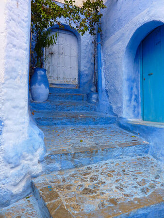 A decorative entryway in the blue-painted mountain village of Chefchaouen, Morocco  Stock fotó