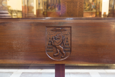 pew: The Lion of St. Jerome, carved into each pew in the church at the monastery of St. Jerome (San Jerónimo) in Granada, Spain. Stock Photo