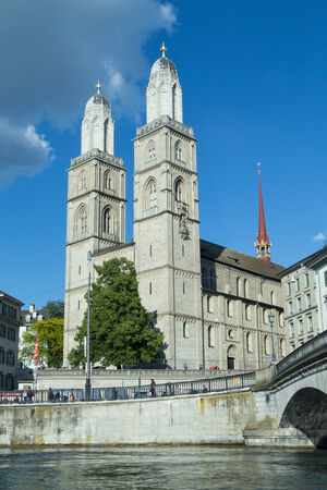 protestant: Grossmünster Church was a monastery church constructed in 1220 and used by Protestant reformer Huldrych Zwingli as the post of his first pastorate beginning in 1520. Stock Photo