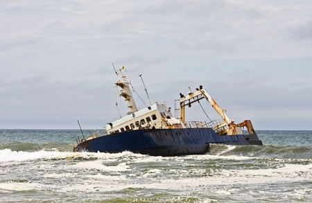 Stranded ship on the Namibian coast Stock Photo