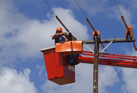 in the heights: Linemen working on powerline Stock Photo