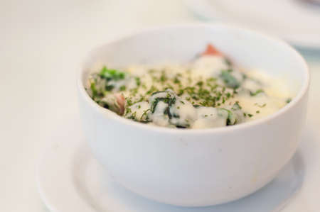 cheesy: Bowl of spinach with a cheesy cream sauce Stock Photo