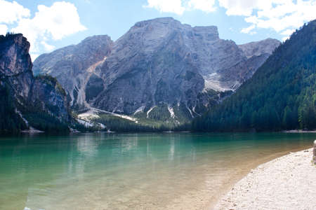 lake at the foot of the dolomites mountains. photo