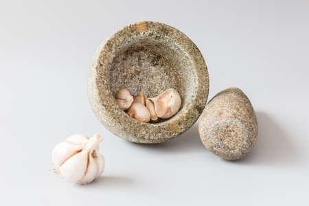 stoneware: Stone mortar with garlic
