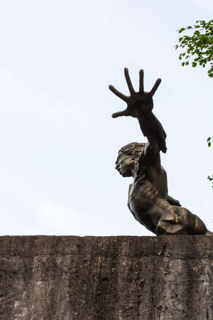 outstretched:  arms outstretched portrait Statue