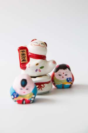 maneki: Close up to maneki Neko on white background Stock Photo