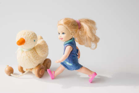 pullet: girl doll and duck doll Editorial