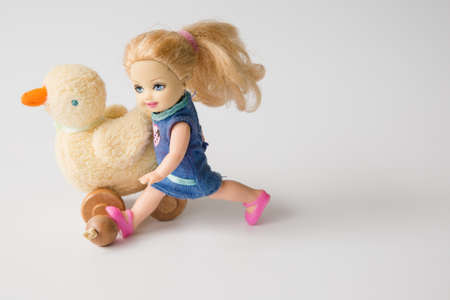 stride: girl doll and duck doll Editorial