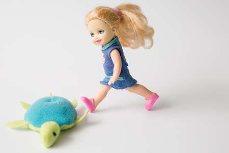 stride: girl doll Editorial