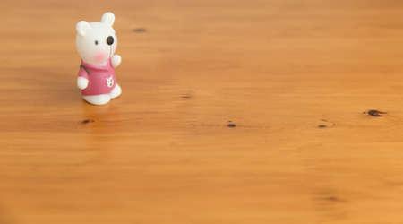 padding: Little bear doll on the desktop Stock Photo