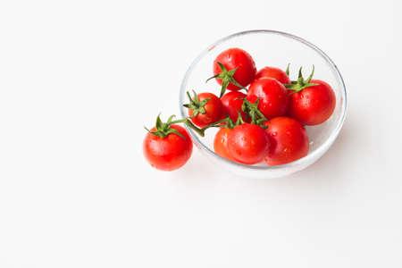 sudio: tomatoes in glass bowl