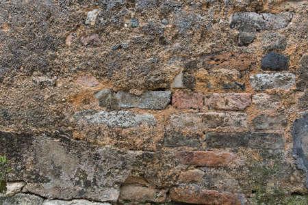 stucco: stucco and brick wall