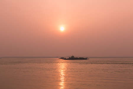 yangtze river: sunset or sunrise by Yangtze river