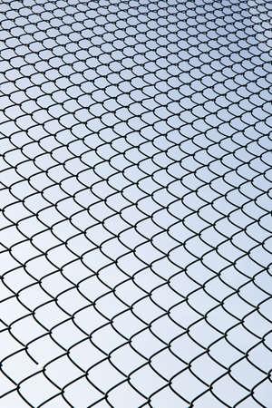 metal mesh: Metal mesh and sky Stock Photo