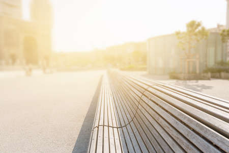 vanishing point: wood bench in city square