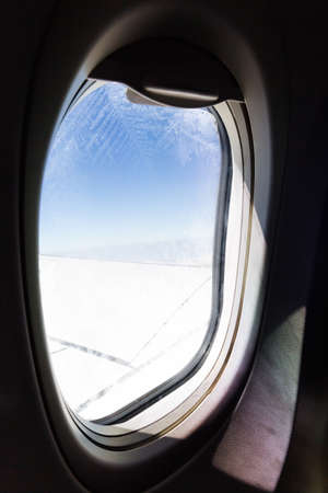 high up: windows of airplane flying high up sky Stock Photo