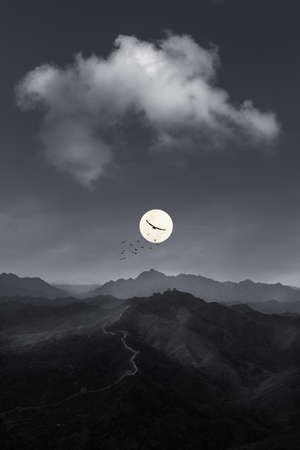 Ancient Great wall and mountain landscape at night with full moon.