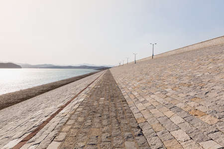 Stone dyke of Yantai Reservoir which is the important water resource of Yantai city. Shandong province, China.