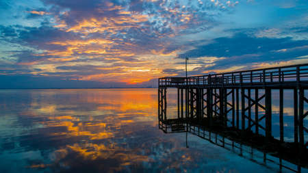 Pier on Mobile Bay, Alabama at sunset