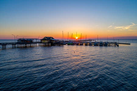 Aerial view of the Fairhope Pier on Mobile Bay at sunset