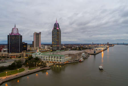 The downtown Mobile, Alabama waterfront skyline at sunset in January of 2021