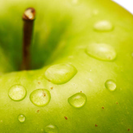 Green apple with waterdrops on its surface photo