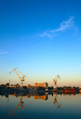 wideangle: Wide-angle photo of cranes in a shipbuilding plant