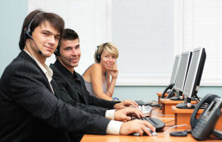 Friendly customer service opeartors, focus on the middle person Stock Photo - 4603318