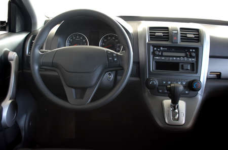 Interior of a car with view on steering wheel and dashboard photo