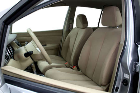 car seat: Front seats of a modern car, light leather.