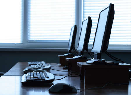 Row of computers in an office Stock Photo