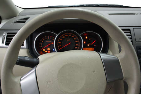 Closeup shot of steering wheel and dashboard photo